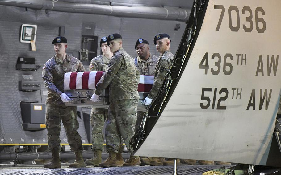 An Army carry team moves a transfer case containing the remains of Spc. Antonio I. Moore, Tuesday, Jan. 28, 2020, at Dover Air Force Base, Del.