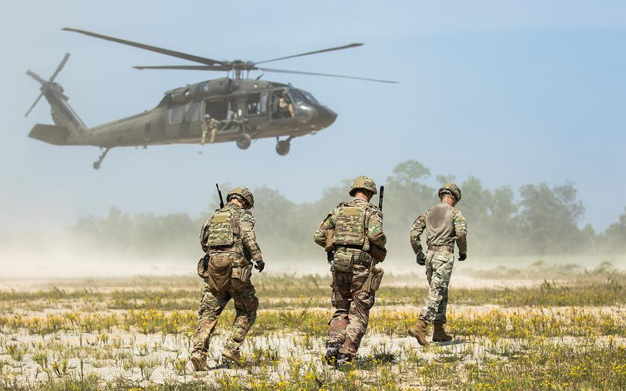 Advisors from 1st Security Force Assistance Brigade, approach a A UH-60L Black Hawk for sling load transportation during the Advisor Forge training exercise at Fort Benning, Ga., on August 13, 2019.