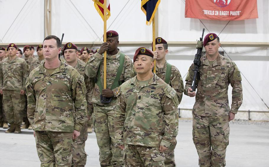 From front left, U.S. Army Col. Andrew O. Saslav, commander of the 1st Brigade Combat Team, and Command Sgt. Maj. Thinh T. Huynh, the departing senior enlisted adviser of 1st Battalion, 504th Parachute Infantry Regiment, 82nd Airborne Division, participate with with soldiers during a change-of-responsibility ceremony in the Central Command area of responsibility on Jan 16, 2020.