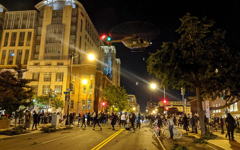A Lakota helicopter from the D.C. Army National Guard hovers over an intersection in downtown Washington on June 1.