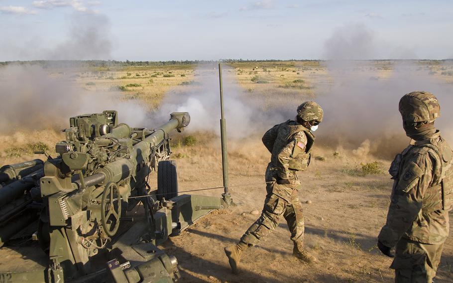 A U.S. Army soldiers assigned to Bravo Battery, 1st Battalion, 119th Field Artillery Regiment, Michigan Army National Guard, fire a M777 155mm howitzer as part of a direct fire training exercise during Northern Strike 20, Camp Grayling, Mich., on July 25, 2020.
