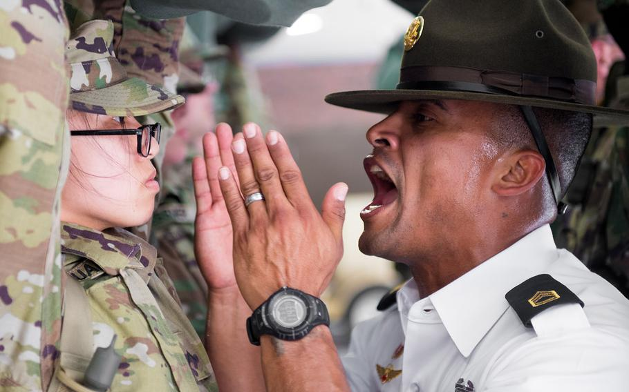 """A U.S. Army drill sergeant assigned to the34th Infantry Regiment uses the """"shark attack"""" method on a recruit during basic training on June 12, 2017, at Fort Jackson, S.C. The Army says it will no longer shout in recruits' faces and use intimidation to establish authority and weed out the weak during basic training."""