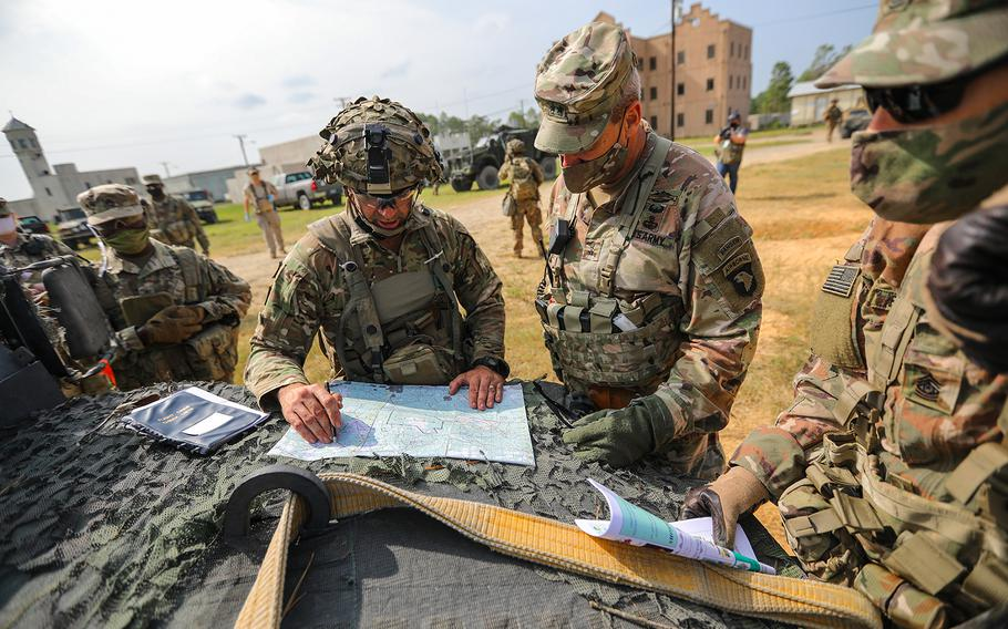 Col. Robert Born, commander of 1st Brigade Combat Team, 101st Airborne Division (Air Assault), briefs Maj. Gen. Brian E. Winski, commanding general of the 101st Airborne Division and Fort Campbell, Ky., about his defensive plan on a map on Sept. 19, 2020, during operations at Joint Readiness Training Center-Fort Polk, La.
