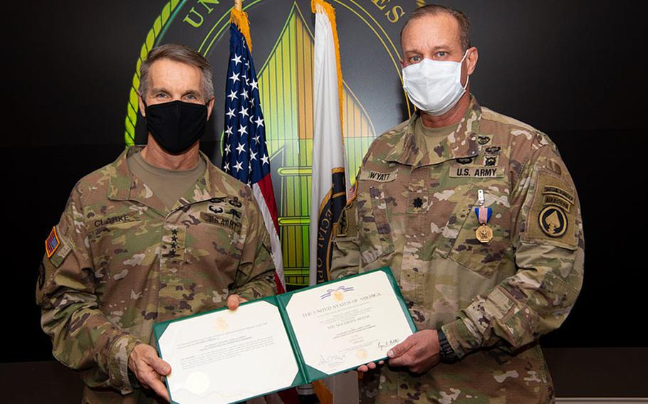Gen. Richard D. Clarke, commander, U.S. Special Operations Command, presents Lt. Col. Larry Wyatt, USSOCOM clinic director, with a Soldier's Medal at MacDill Air Force Base, Fla., Dec. 22, 2020. He was awarded the medal for delivering lifesaving care to two people after a motorcycle collided with bicyclists April 7, 2019, despite being injured himself.