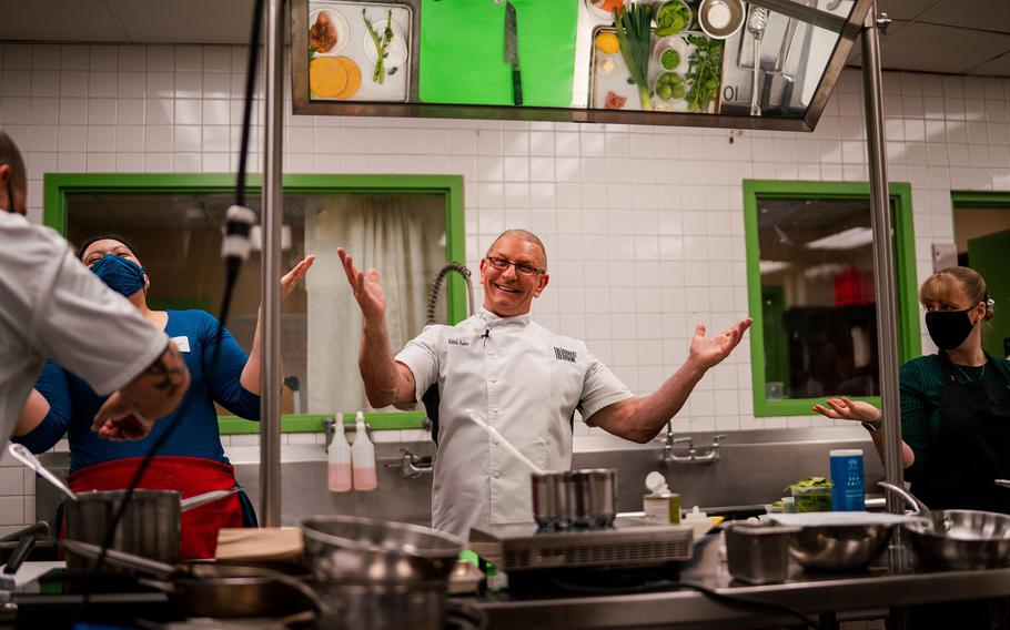 Chef Robert Irvine engages with others at the Culinary University on Joint Base Lewis-McChord, Wash., Jan. 25, 2021. The Army recruited Irvine, a fixture at holiday USO shows downrange in recent years, to help find ways to attract younger troops to the dining facilities.