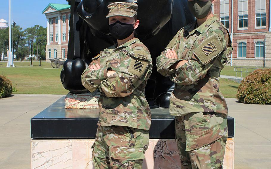 Army 1st Lt. Trisha Burden, right, and 2nd Lt. Amanda Atkinson, both assigned to 9th Brigade Engineer Battalion, 2nd Armored Brigade Combat Team, 3rd Infantry Division, pose for a photo on Fort Stewart, Ga., on April 7, 2021. They will compete in 14th annual Lt. Gen. Robert B. Flowers Best Sapper Competition at Fort Leonard Wood, Mo., on May 1-3, 2021.
