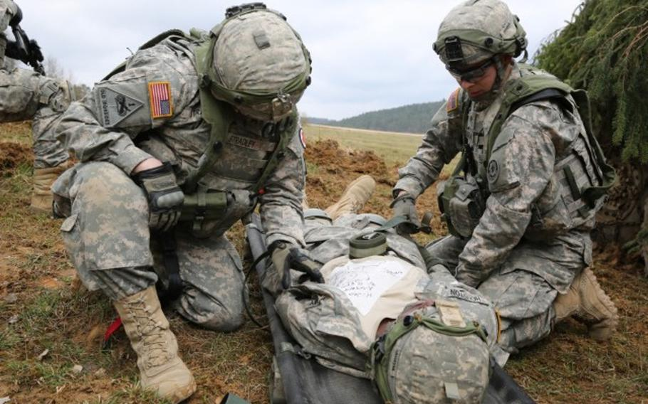 Soldiers assigned to Bravo Troop, 1st Squadron, 2nd Cavalry Division strap a soldier with a simulated injury to a litter during an exercise in Hohenfels, Germany, April 12, 2015. StatBond, a gel developed with military funding, may allow medics to stop arterial bleeding without the need for compression, Army Research Laboratory officials said May 4, 2021.