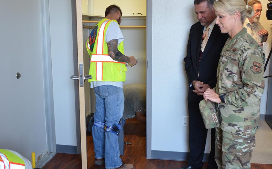 Brig. Gen. Laura Lenderman, commander of the 502nd Air Base Wing and Joint Base San Antonio, and Richard Trevino, director of the 502nd Civil Engineer Group, review mold remediation work underway Thursday in a dorm room in Building 1215 at Lackland Air Force Base in Texas.