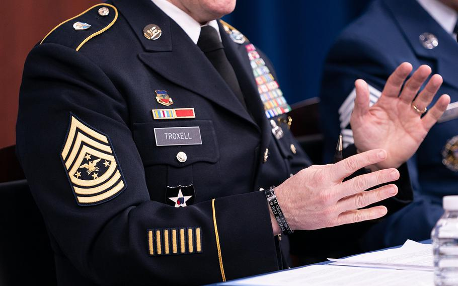 Army Command Sgt. Maj. John Wayne Troxell, senior enlisted adviser to the chairman of the Joint Chiefs of Staff, speaks as he prepares to depart the position during a news briefing in the Pentagon Press Briefing Room  on Dec. 9, 2019, in Washington. Troxell wore the new rank insignia for his position while meeting with reporters Monday ahead of his retirement Friday.