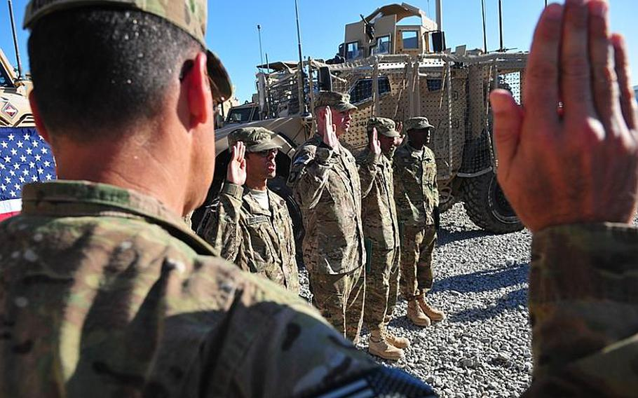 A mass re-enlistment takes place in Afghanistan in October. Under new guidelines, brigade-level commanders have the authority to decide which soldiers will be allowed to re-enlist.