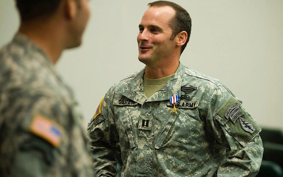 Then-Army Capt. Mathew Golsteyn is congratulated following a Valor Awards ceremony for 3rd Special Forces Group at Fort Bragg, N.C., on Jan. 4, 2011.