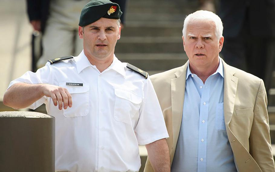 Maj. Mathew Golsteyn leaves the Fort Bragg courtroom facility with his civilian lawyer, Phillip Stackhouse, right, after a hearing on Thursday, June 27, 2019.