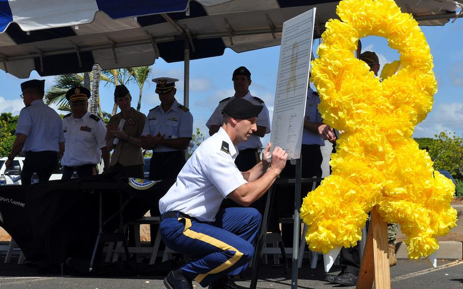 Col. Mark Schoenfeld, 9th Mission Support Command chief of staff, signs the 2019 Joint Services Suicide Prevention Proclamation on World Suicide Prevention Day in Honolulu, Hawaii, Sept. 10, 2019.