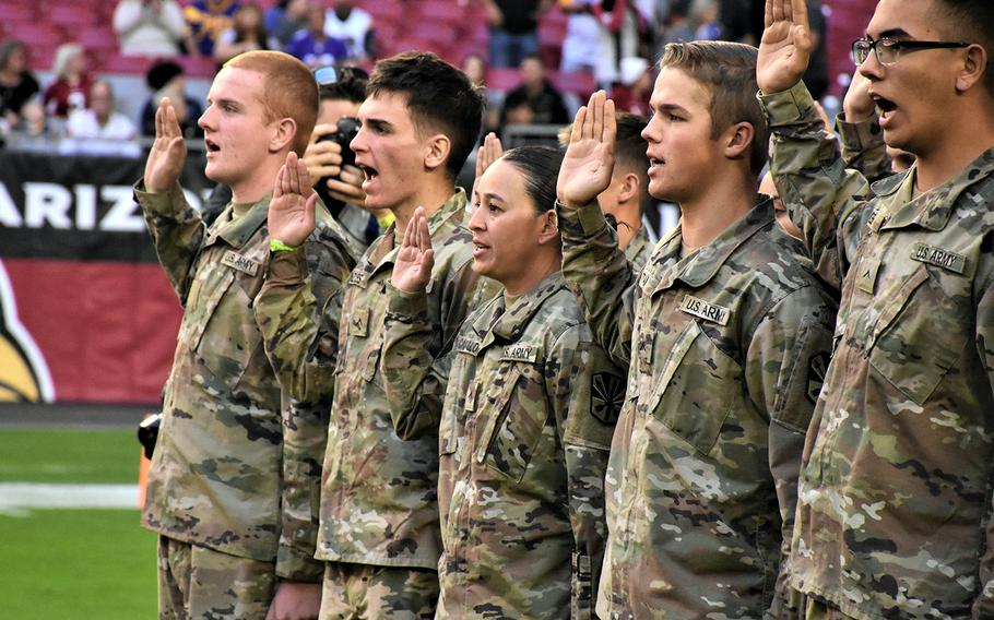 Future soldiers recite the oath of enlistment during a ceremony at State Farm Stadium in Glendale, Ariz., Dec. 1, 2019.