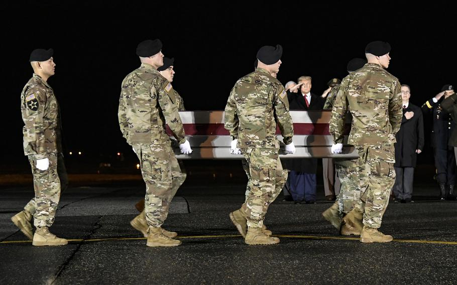 A U.S. Army carry team transfers the remains of Sgt. 1st Class Javier J. Gutierrez, of San Antonio, Texas,  at Dover Air Force Base, Del., Feb. 10, 2020.