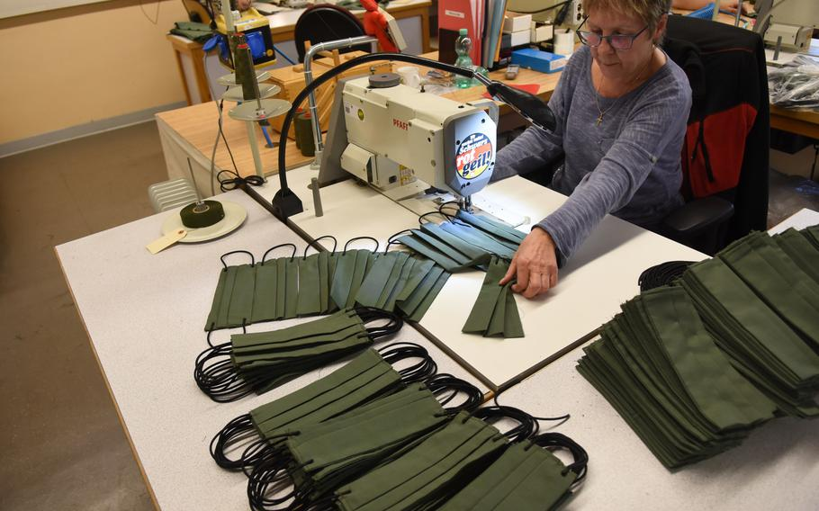 Jutta Gerber, a seamstress, puts the finishing touches on face masks she and her colleagues began making this week for the Theater Logistics Support Center Europe, a mostly German workforce that supports the U.S. Army in Europe.