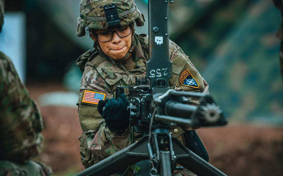 Army Sgt. Yulema Cortez, 2nd Cavalry Regiment, operates a M2 .50-caliber machine gun as part of preliminary training for the Expert Infantryman Badge and the Expert Soldier Badge in Bemowo Piskie, Poland, March, 19, 2020.