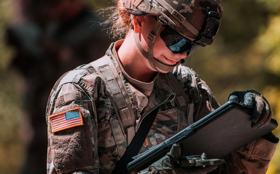 A soldier assigned to the 2nd Cavalry Regiment reviews a map while testing for the Expert Infantryman Badge and the Expert Soldier Badge in Vilseck, Germany, June 1, 2020.