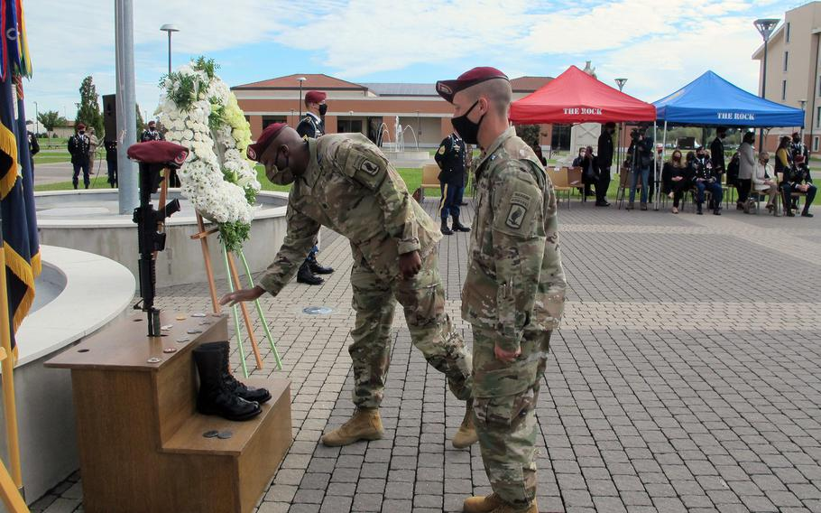 A soldier with the 173rd Airborne Brigade leaves a coin while rendering honors to Sgt. Cade Pendergraft during a memorial Friday, Oct. 16, 2020, at Caserma Del Din in Vicenza, Italy. Pendergraft died in a hiking accident in September 2020.
