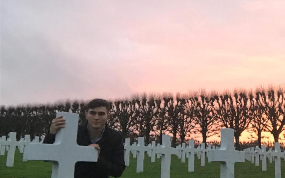 Sgt. Cade Pendergraft visits the grave of his great-grandfather Capt. Joseph Gray Duncan, Jr., in the Meuse-Argonne American Cemetery in France. The 173rd Airborne Brigade memorialized Pendergraft, who died in a hiking accident in Italy in September, in a ceremony Oct. 16, 2020.