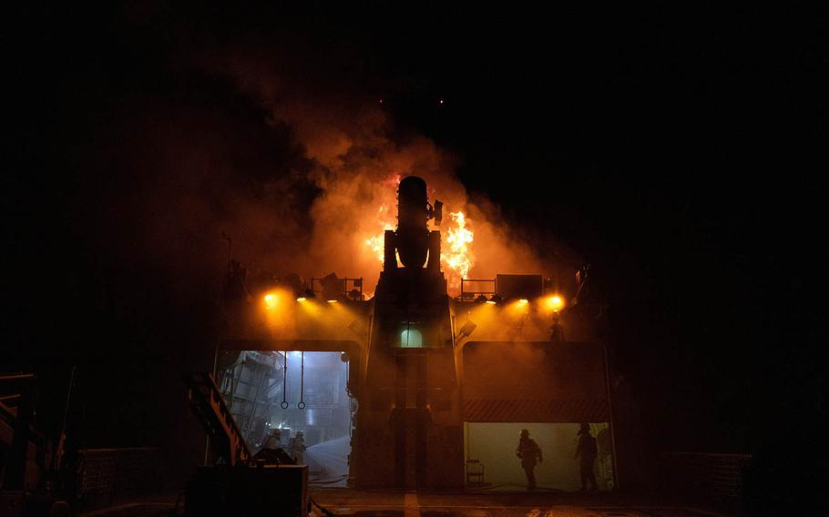 Fire teams battle a blaze aboard the Coast Guard cutter Waesche in the western Pacific Ocean, Sept. 19, 2020.