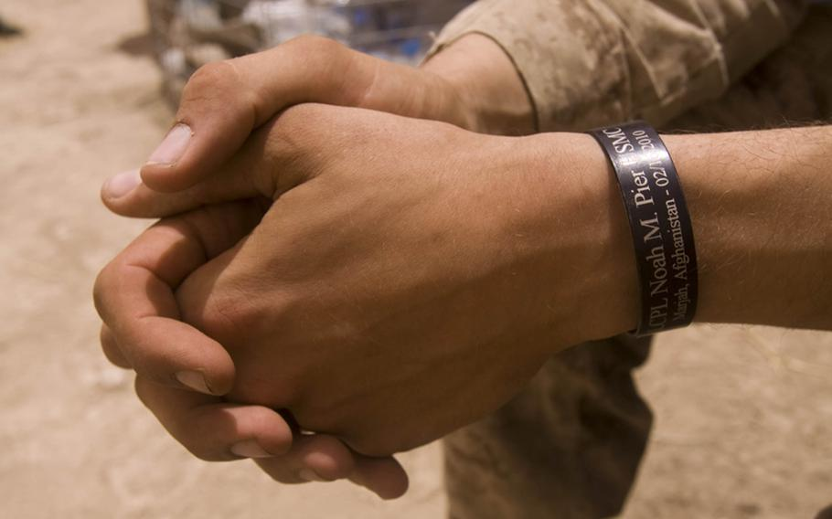 Lance Cpl. Jeffrey P. Grivois, a fire team leader with 3rd Platoon, Company B, 1st Battalion, 3rd Marine Regiment, wears a metal bracelet to honor his friend, Lance Cpl. Noah M. Pier, who was killed in action in January 2011.