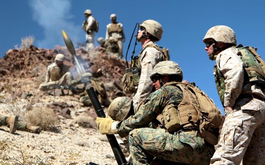Students at the Infantry Officers' Course fire a mortar round during a mountain attack in the Bullion Training Area at Twentynine Palms, Calif., March 21, 2012.