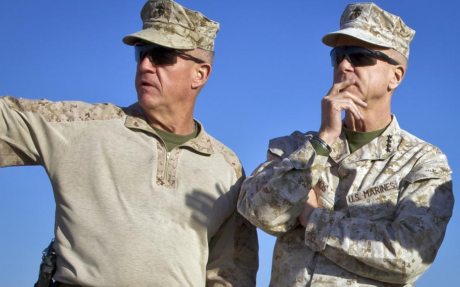 U.S. Marine Corps Gen. James F. Amos, right, the commandant of the Marine Corps, speaks with Maj. Gen. Charles M. Gurganus, the commanding general of the International Security Assistance Force Regional Command Southwest, during a tour of Camp Leatherneck, Helmand province, Afghanistan, Feb. 9, 2013.