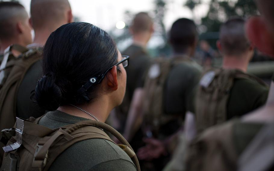 U.S. Marines from Delta Company, Infantry Training Battalion, School of Infantry-East receive instruction from combat instructors before navigating their way through the obstacle course at Camp Geiger, N.C., on Oct 4, 2013.