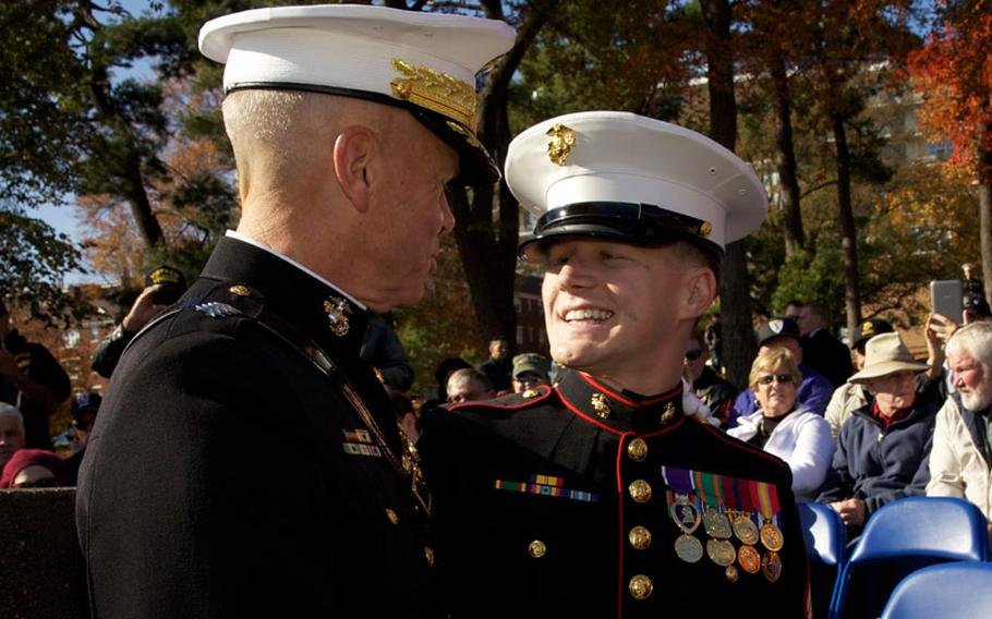 The 35th Commandant of the Marine Corps, Gen. James F. Amos, left, speaks with Cpl. Kyle Carpenter before the annual wreath-laying ceremony at the Marine Corps War Memorial in Arlington, Va., on Nov. 9, 2013.