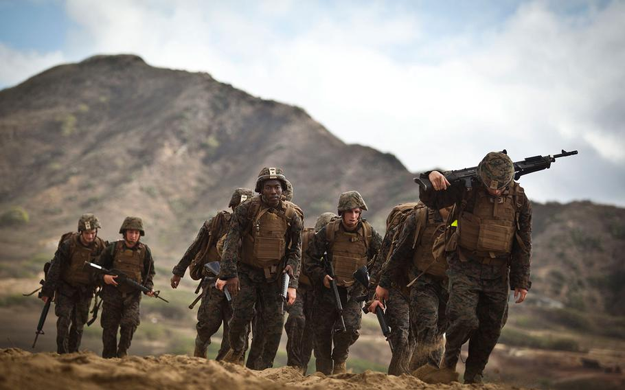 Marines hike along Fort Hase Beach in Hawaii on April 21, 2016