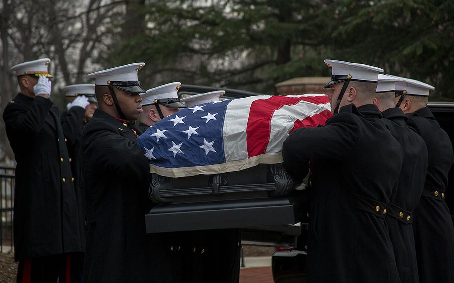 Marines prepare to carry Maj. Gen. Paul A. Fratarangelo to his final resting place at Arlington National Cemetery on Jan. 16, 2018.