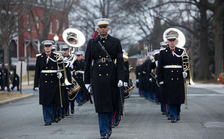 Capt. Ryan Davis, funeral staff marcher with Headquarters and Service Company, Marine Barracks Washington D.C., marches at the front of a formation during a full honors funeral for Maj. Gen. Paul A. Fratarangelo at Arlington National Cemetery, Arlington, Va., Jan. 16, 2018.
