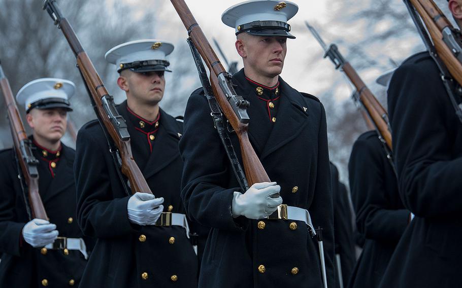 Marines with Alpha Company, Marine Barracks Washington D.C., march in formation during a full honors funeral for Maj. Gen. Paul A. Fratarangelo at Arlington National Cemetery, Arlington, Va., Jan. 16, 2018.