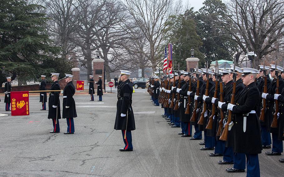 Marines with Marine Barracks Washington D.C. render honors during a full honors funeral for Maj. Gen. Paul A. Fratarangelo at Arlington National Cemetery, Arlington, Va., Jan. 16, 2018.