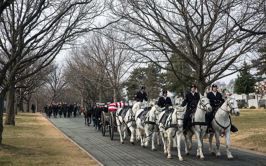 Marine Corps Body Bearers, Bravo Company, Marine Barracks Washington D.C., march behind members of the Caisson Platoon during a full honors funeral for Maj. Gen. Paul A. Fratarangelo at Arlington National Cemetery, Arlington, Va., Jan. 16, 2018.