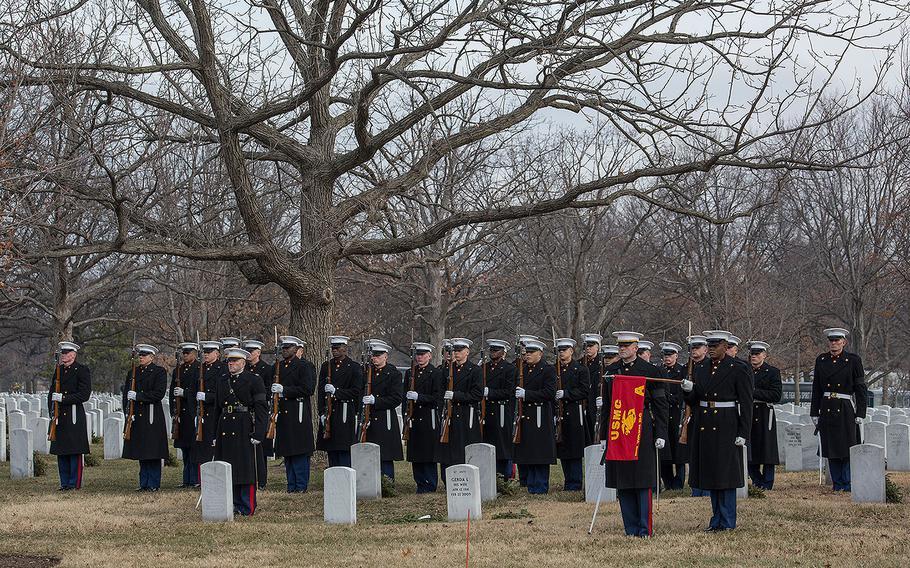Marines with Alpha Company, Marine Barracks Washington D.C., render honors during a full honors funeral for Maj. Gen. Paul A. Fratarangelo at Arlington National Cemetery, Arlington, Va., Jan. 16, 2018.