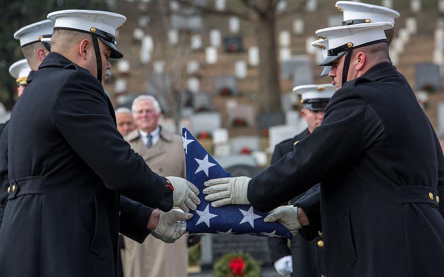 Marine Corps Body Bearers, Bravo Company, Marine Barracks Washington D.C., fold the U.S. flag during a full honors funeral for Maj. Gen. Paul A. Fratarangelo at Arlington National Cemetery, Arlington, Va., Jan. 16, 2018.