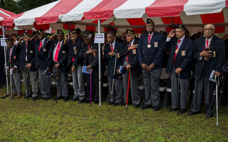 Montford Point Marines salute the colors during the Montford Point Marine Memorial gifting ceremony at the Montford Point Marine Memorial in Jacksonville, N.C., July 25, 2018.