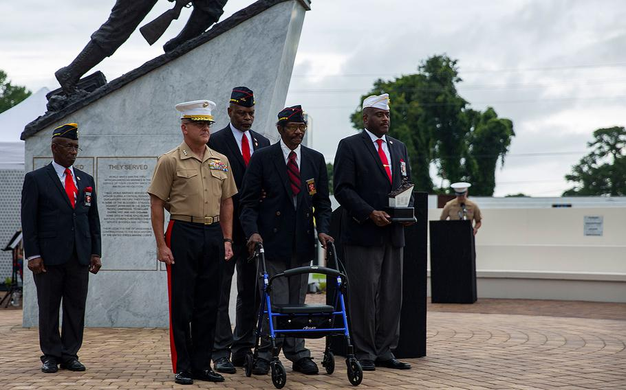Lt. Gen. Robert F. Hedelund, commanding general, II Marine Expeditionary Force, receives a gift during the Montford Point Marine Memorial gifting ceremony at the Montford Point Marine Memorial in Jacksonville, N.C., July 25, 2018.