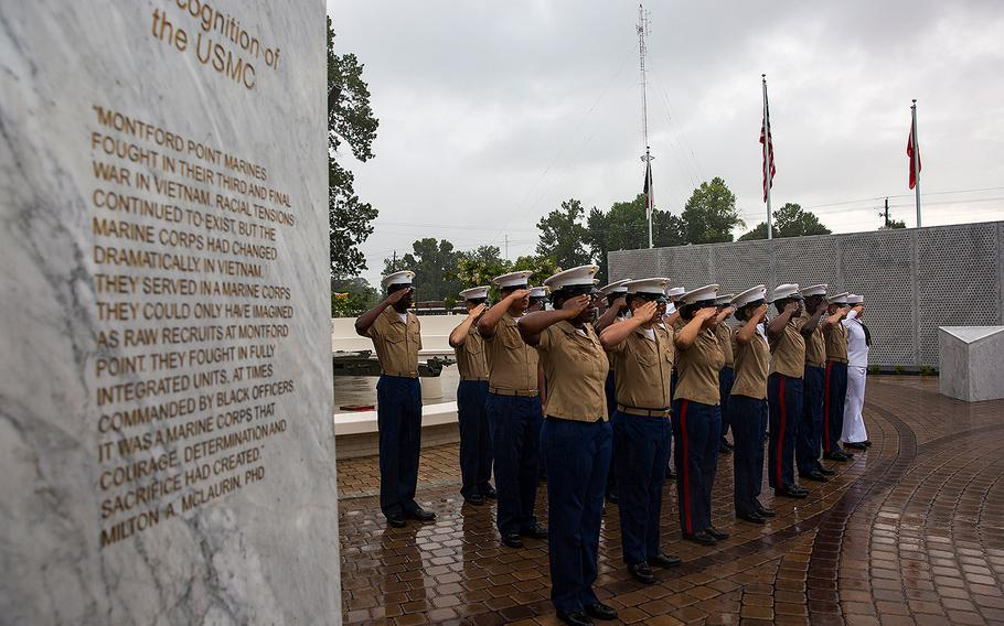 Marines with 2nd Supply Battalion, 2nd Marine Logistics Group, salute during the Montford Point Marine Memorial gifting ceremony at the Montford Point Marine Memorial in Jacksonville, N.C., July 25, 2018.