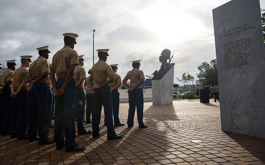 Marines with 2nd Supply Battalion, 2nd Marine Logistics Group, stand in formation during the Montford Point Marine Memorial gifting ceremony at the Montford Point Marine Memorial in Jacksonville, N.C., July 25, 2018.
