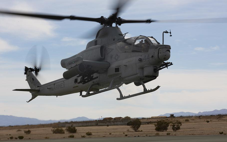 An AH-1Z with Marine Light Attack Helicopter Squadron 369, Marine Aircraft Group 39, 3rd Marine Aircraft Wing, takes off during a training exercise at Marine Corps Air Ground Combat Center Twentynine Palms, Calif., Feb. 15, 2019.
