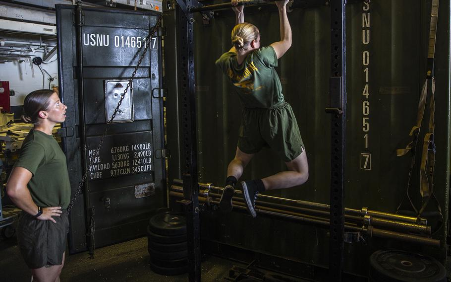 U.S. Marines with the Female Engagement Team, 26th Marine Expeditionary Unit, participate in a pull-up competition aboard the amphibious assault ship USS Bataan during Amphibious Ready Group, MEU exercise at sea on Sept, 4, 2019.