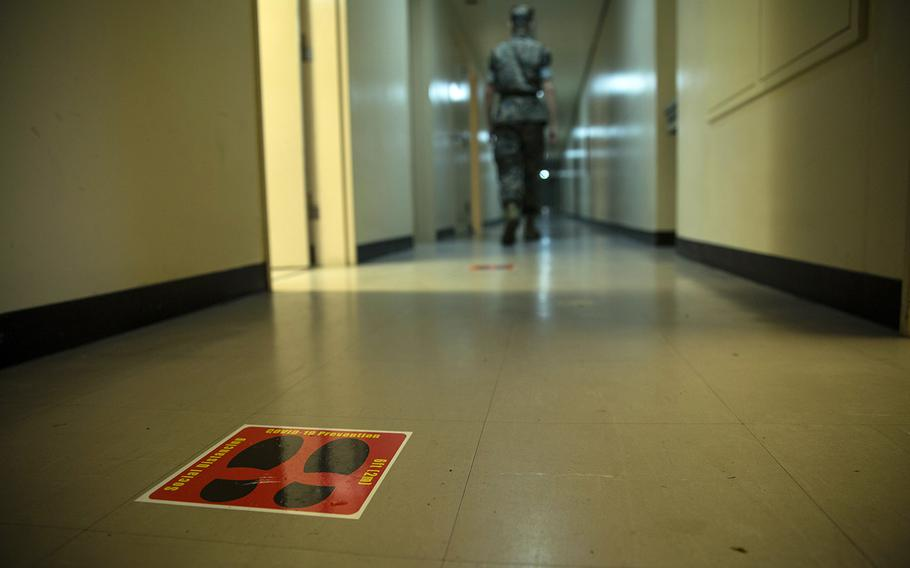A social distancing reminder is displayed on the floor of a barracks at Camp Hansen, Okinawa, on April 22, 2020.