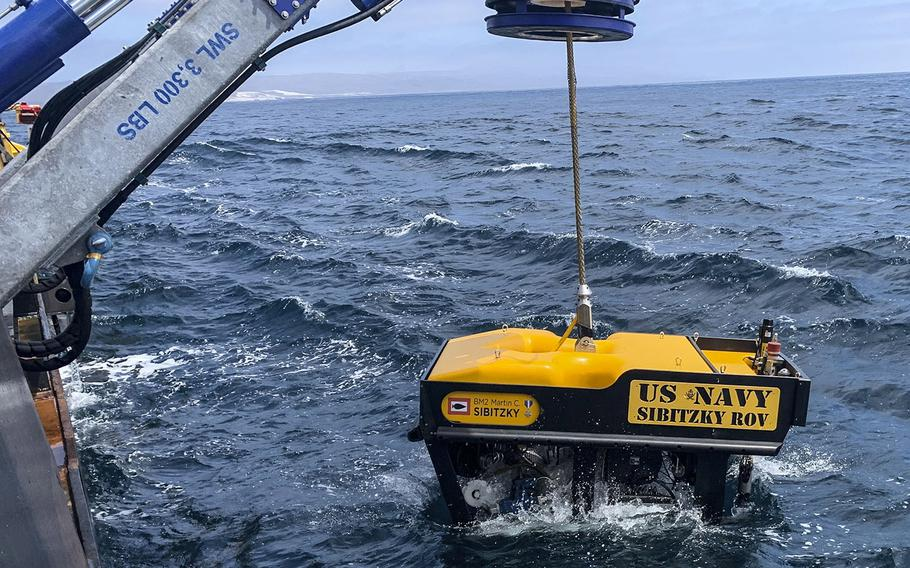 Undersea Rescue Command deploys the Sibitzky Remotely Operated Vehicle from the deck of the Military Sealift Command-chartered merchant vessel HOS Dominator in the Pacific Ocean, August 3, 2020, during recovery efforts for the missing seven Marines and one sailor from the 15th Marine Expeditionary Unit.