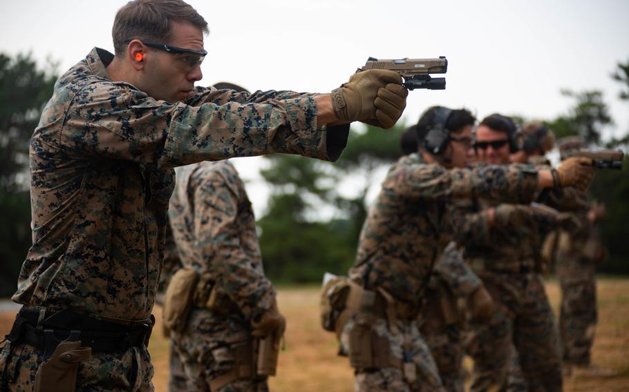Marine Corps Cpl. Thomas Wilson with 3rd Reconnaissance Battalion, 3rd Marine Division, conducts close-quarters battle training at Camp Schwab, Okinawa, Japan, on Jan. 26, 2021. The Marine Corps wants an improved combat uniform with fire protection, without sacrificing the durability and comfort of the existing digital-pattern combat utility uniform.