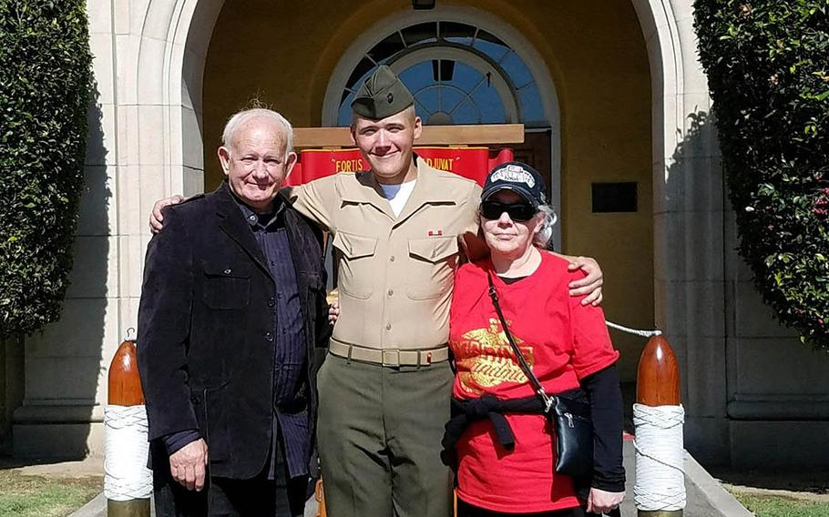 Pfc. Evan Bath with his grandparents, Larry and Linda Williamson, at his graduation from boot camp in 2019 at Marine Corps Recruit Depot, San Diego, Calif.