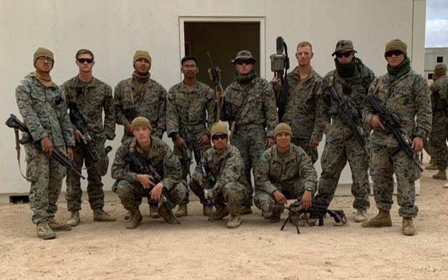 Marine Pfc. Evan Bath, front left, with other members of Bravo Company, Battalion Landing Team 1/4.