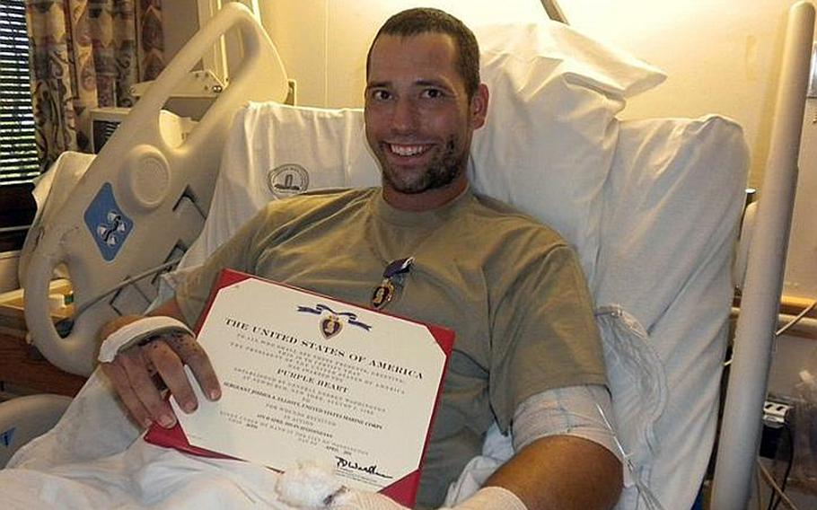 Sgt. Elliott after being awarded the Purple Heart in his hospital bed after the April 18 IED attack.